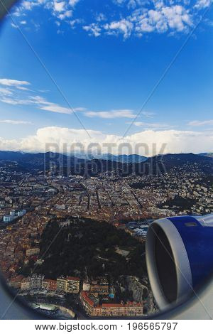 NICE FRANCE - August 16th 2016: Aerial view of the city of Nice France and surrounding coastline while landing at Nice Airport on a serene summer afternoon