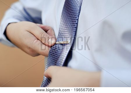 The Groom Puts On His Tie. A Business Man Is Dressing A Tie.