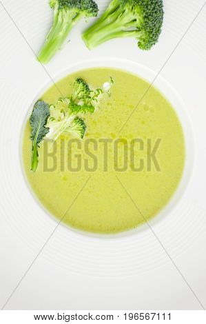 Cream Of Broccoli Soup Close-up In A White Plate..