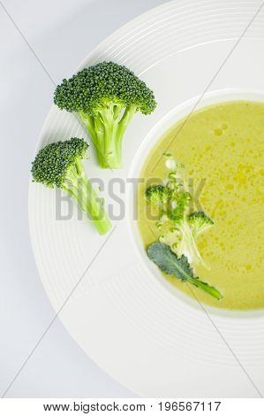 Cream Of Soup And Inflorescences Of Broccoli Close-up In A White Plate..