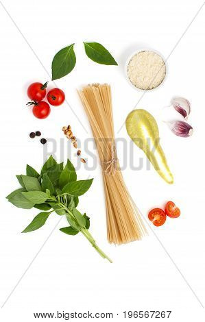 Ingredients For Cooking Spaghetti With Pesto Sauce And Tomatoes On A White Background..