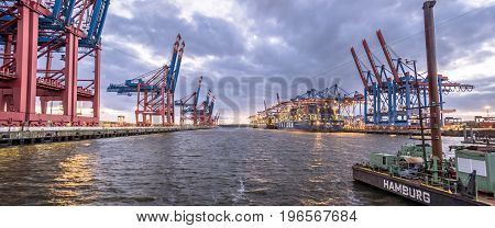HAMBURG , GERMANY - JULY 12 2017: Container gantry cranes of the terminal Eurogate getting ready for unloading ships in the deepwater port Hamburg-Waltershof