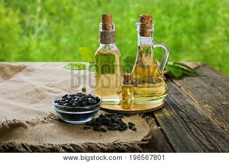 Vegetable oil of sunflower. Sunflower oil on a wooden table. Side view.