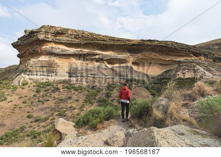 Tourist Trekking On Marked Trail In The Golden Gate Highlands National Park, South Africa. Scenic Ta