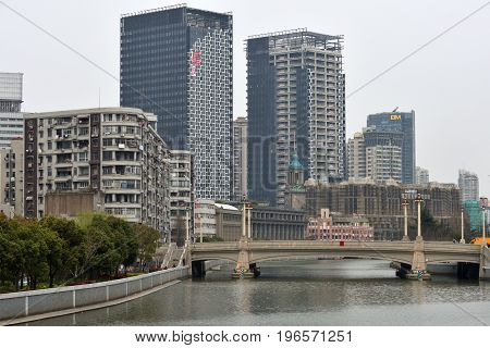 SHANGHAI CHINA - MARCH 20: Suzhou Creek on March 20 2016 in Shanghai China. Suzhou Creek (or Soochow Creek) also called Wusong River is a river that passes through the Shanghai city centre.