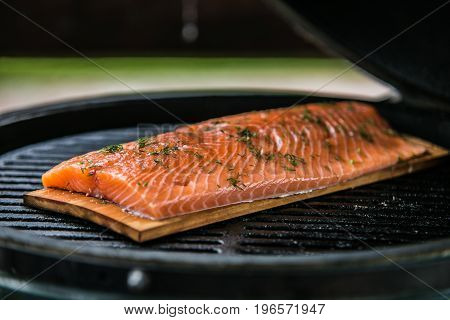 fresh salmon fillets being cooked on grill