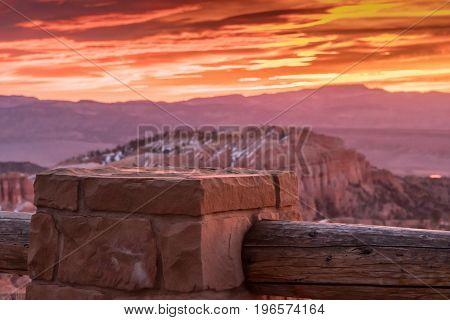 Stone Pillar Of Fence At Sunrise