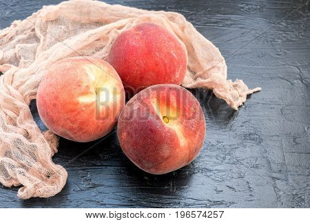 Peaches On Dark Background.