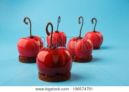 Glossy Mousse Cakes In The Form Of Cherries
