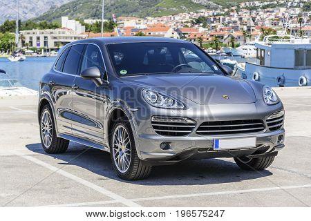 MAKARSKA RIVIERA, CROATIA - 4 JULY, 2017: Premium car Porsche Cayenne in the parking lot.