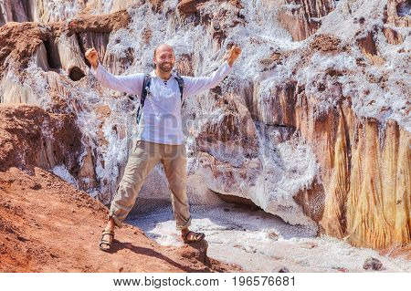 Mature man welcomes nature during the scenic journey Hormuz Island Hormozgan Province Southern Iran.