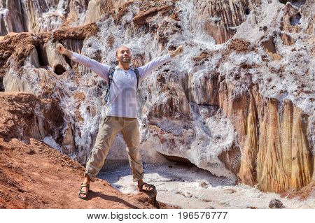 A mature man welcomes nature while traveling to picturesque places Hormuz Island Hormozgan Province Southern Iran.