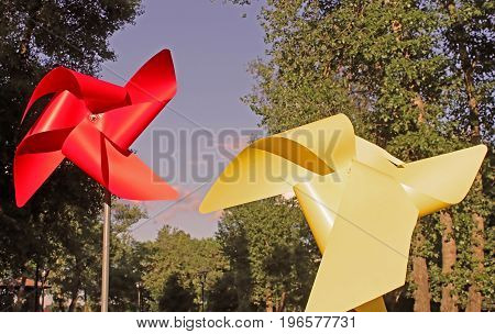 Large red and yellow children pinwheels in the Natalka park, Kyiv, Ukraine.Vintage filter