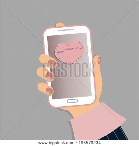 A mobile phone in the female`s hand. A smartphone in businesswoman`s hand. A sleeve of pink shirt and a blue striped suit. Red nails. A massage