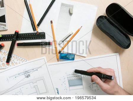 Designer workplace. Engineer projects furniture top view. Drawings and stationery.