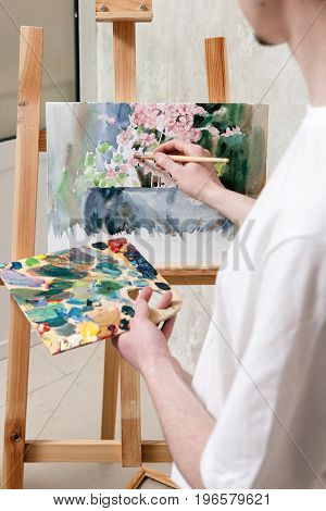 Still-life painting is drawing by unrecognizable artist. Beautiful work of art in process of producing. Painter's workshop, new masterpiece, creativity and leisure concept