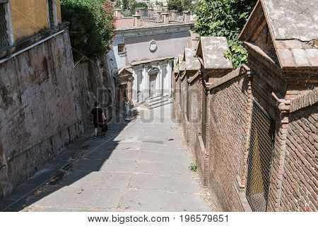 Rome Italy - August 20 2016: Steps near San Pietro in Montorio in picturesque neighbourhood of Trastevere in Rome a sunny summer day.