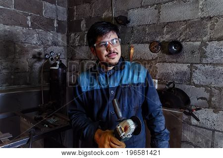 A construction worker using an angle grinder