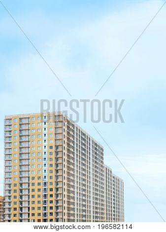 New residential building under construction. Against blue sky with copy space