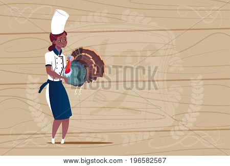 Female African American Chef Cook Holding Turkey Cartoon Chief In Restaurant Uniform Over Wooden Textured Background Flat Vector Illustration