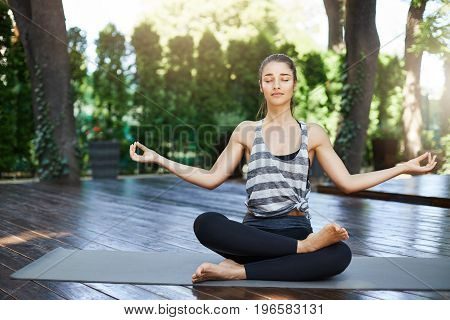 Beginner female yogi getting ready for her daily yoga practice in a busy city
