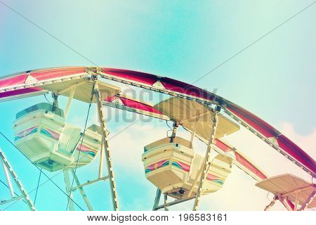 Abstract view photography of a ferris wheel ride with rainbow filter.