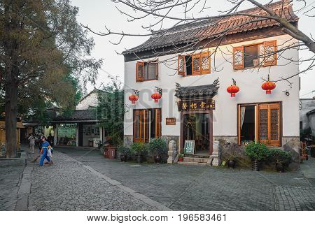 Suzhou, China - Nov 5, 2016: Xi Yi Tang. Hui Ya Tavern at the historic Zhouzhuang Water Town. A few classical red lanterns are hung outside store.