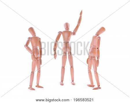 Wooden dummies one showing and two looking up. Perspective idea growth development and project concept. Isolated on white