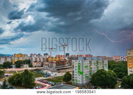 Lightning Over Housing Estate. Storm in the City.