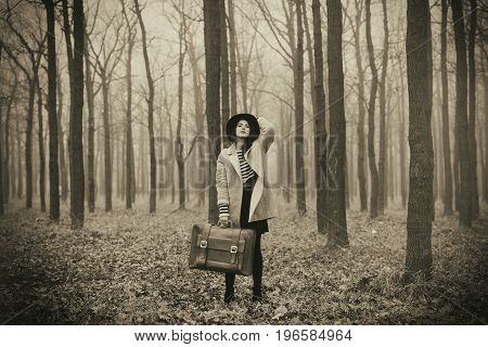 Portrait Of A Young Woman With  Suitcase