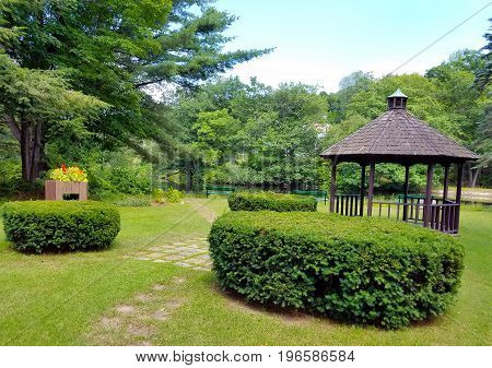 Gazebo in the park with a river in the distance