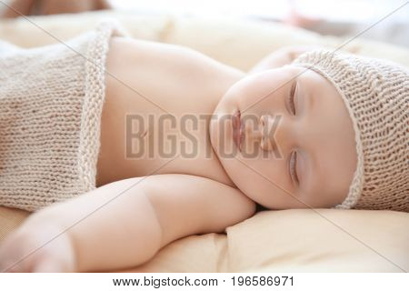 Cute little baby sleeping on lounge at home, closeup