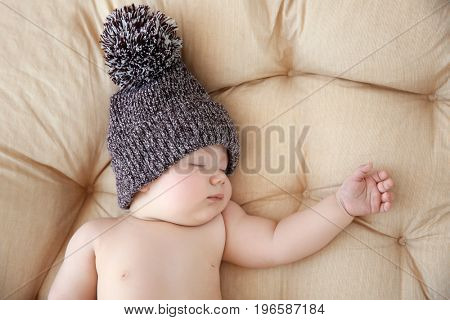 Cute little baby sleeping on lounge at home