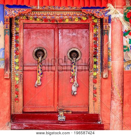 Traditional Tibetan doors at Diskit Monastery in Ladakh, Kashmir, India