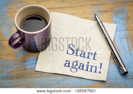 Start again motivational reminder or advice - handwriting on a napkin with a cup of espresso coffee