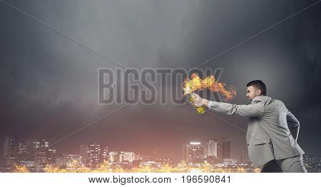 Businessman throwing petrol bomb