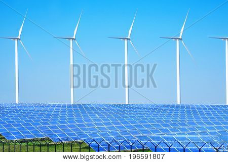 Solar panels and wind turbines in field. Concept of eco friendly thechnologies