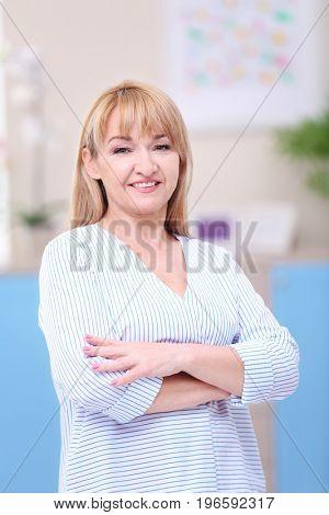 Portrait of attractive mature woman indoors