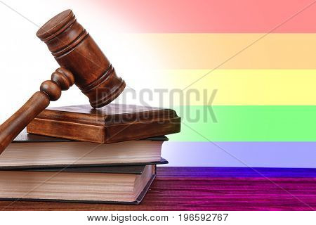 Judge's gavel and books on wooden table. Gay rights concept