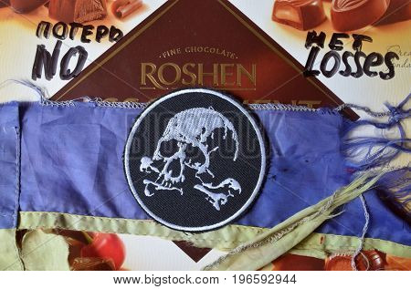 ILLUSTRATIVE EDITORIAL.Chevron of Ukrainian Army. With logo Roshen Inc. Trademark Roshen is property of Ukrainian president Poroshenko.Incription -   No losses (RUS).Kiev,Ukraine.July 23, 2017