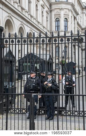 London, UK - 5 June 2017: Armed police guard the entrance to Downing Street, home of the Prime Minister. Security is stepped up prior to the UK General Election and after terrorism attacks in the city