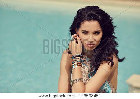 Model Posing Next to Swimming Pool in garden