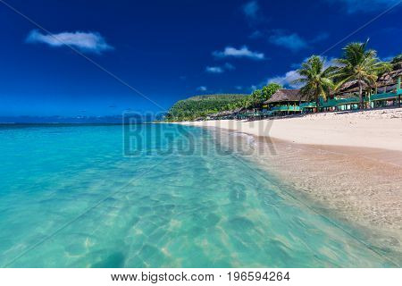 Lalomanu beach with open huts called fales, south side of Upolu Island, Samoa