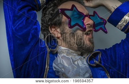 Hipster, Man with beard dressed like a pirate and ridiculous glasses, funny and humorous, costume party