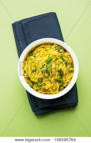 fried Patta Gobhi or Gobi with green peas sabji OR Cabbage sabzi is the traditional Indian dish, selective focus