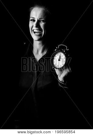 Smiling Woman Isolated On Black Showing Alarm Clock