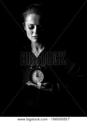 Woman Isolated On Black Background Showing Alarm Clock