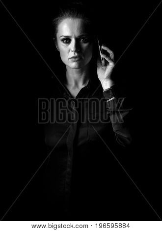 Woman In Dark Dress Isolated On Black Talking On Mobile Phone