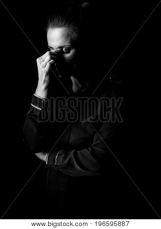 Portrait Of Stressed Woman In Dark Dress Isolated On Black