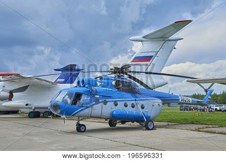 ZHUKOVSKY, RUSSIA, JUL. 21, 2017: Aerospace aircraft exhibition MAKS 2017. Russian helicopter Mi-8T for civil transportation purposes. Blue white civil helicopter. Civil military planes helicopters